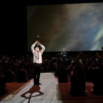 "Clarinetist Kari Krikku, conductor Esa-Pekka Salonen, and members of the New York Philharmonic in Kaija Saariaho's ""Circle Map"" at the Park Avenue Armory"