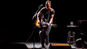 """Bruce Springsteen performs in his musical memoir """"Springsteen on Broadway"""" at the Walter Kerr Theatre."""