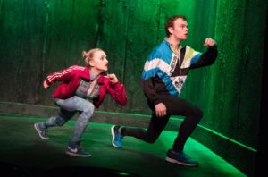 """Evanna Lynch and Colin Campbell in Enda Walsh's """"Disco Pigs"""" at the Irish Repertory Theatre."""